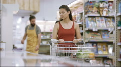4K Customer shopping in frozen food aisle of supermarket Stock Footage
