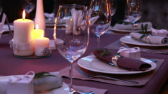 Luxury restaurant table layout with red roses for a romantic dinner Stock Footage