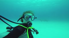 Diver girl shoot herself with floating shark underwater. Ocean wildlife. Extreme Stock Footage