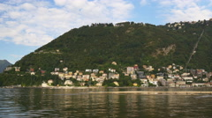 Summer day famous como lake village mountain side panorama 4k italy Stock Footage