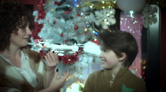 4k Christmas and New Year Holiday Child Showing his Present Drone to Mom Stock Footage
