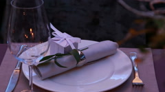 Restaurant table layout with nice presents for a romantic dinner Stock Footage