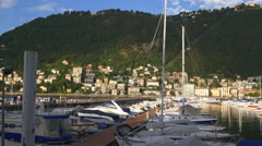 Sunset light famous como lake private yacht dock panorama 4k italy Stock Footage