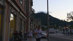 Twilight famous como lake city bay lungo lario trieste walk panorama 4k italy Stock Footage