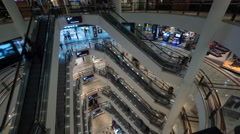 Timelapse of people on escalators in multistorey shopping mall Stock Footage