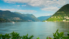 Sunny day como lake bay greens mountain coastline panorama 4k time lapse italy Stock Footage