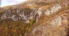 An unspoiled nature, autumn and its colorful trees with a waterfall Stock Footage