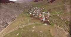 Aerial footage of an ethno village high in the mountains, the shot is moving Stock Footage