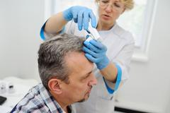 Baldness. diagnostics hair and scalp Stock Photos