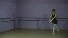 Pretty ballerina making a pose in a hall Stock Footage