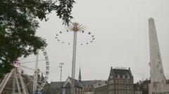 AMSTERDAM, NETHERLANDS - 16 oct 2016, amusement Park - Ferris wheel on Dam Stock Footage