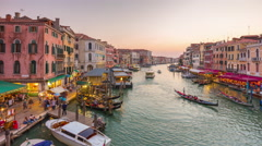 Sunset rialto bridge grand canal traffic panorama 4k time lapse venice italy Stock Footage