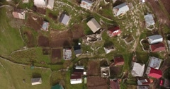 Vertical aerial footage of an old village high in the mountains Stock Footage