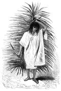 Man carrying a palm frond and knife, vintage engraving. Stock Illustration