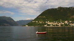 Summer day famous como lake men riding boat oier panorama 4k italy Stock Footage