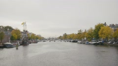 Historically authentic frigate moored on the canal in Amsterdam, Holland Stock Footage