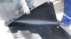 The roofer cuts roofing material Stock Footage