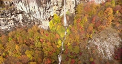 Aerial footage of an unspoiled nature, fall, its colorful trees and a waterfall Stock Footage