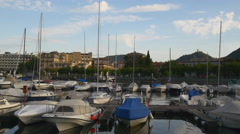 Sunset light famous como lake private yachts dock 4k italy Stock Footage
