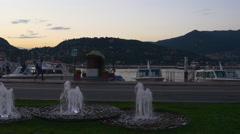 Summer twilight como lake city bay fountain panorama 4k italy Stock Footage