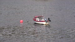 Lone fishing/work boat at anchor Stock Footage