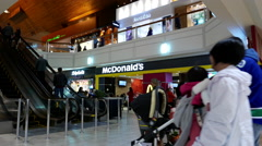 Motion of people line up for ordering food at mcdonalds check out counter Stock Footage