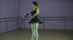 Classical Ballet dancer side view. Beautiful graceful ballerine in black Stock Footage
