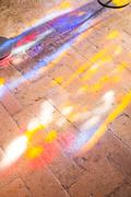Colorful light spots on the the floor in church Stock Photos