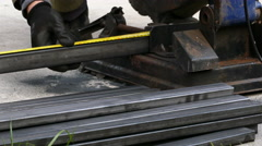 Measuring and cutting metal pipe Stock Footage