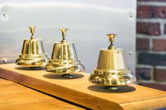 Three shiny golden vintage bells Kuvituskuvat