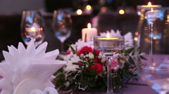 Beautiful luxury Table Serving For A Romantic Dinner With Candles And Red Stock Footage