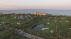 Aerial footage. Sunset time. Flying above golf field at West Palm Beach. 4K Stock Footage