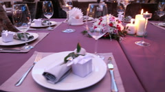 Beautifull festive table laid for an important event wedding or presentation Stock Footage