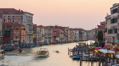 Sunset light rialto bridge grand canal traffic 4k time lapse venice italy Stock Footage