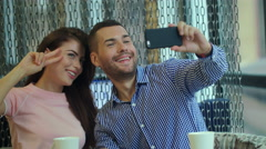 Trendy Couple taking a Selfie with a phone, in a coffeeshop Stock Footage