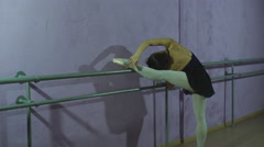 Beautiful graceful dancer performs elements of ballet Stock Footage