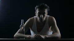 Portrait of a drunk alcoholic man in a dark room. man in despair Stock Footage