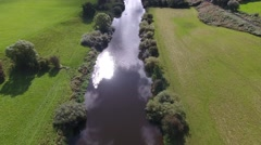 Titling aerial view over a river in the countryside. Stock Footage