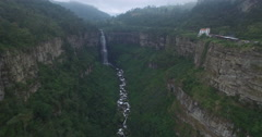 Wide aerial shot moving slowly towards the crashing waters of Tequendama Stock Footage