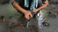 Machete sharpening, Borneo Stock Footage