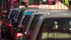Timelapse of taxi cars waiting for clients in night Hong Kong Stock Footage