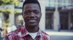 Afro-american man smiles and looks right at camera Stock Footage