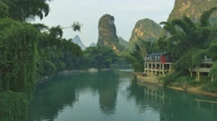 Beautiful landscape with green river floating in a karst landscape in China Stock Footage
