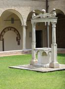 Well to collect rainwater in the cloister of an ancient monastery in europe Stock Photos