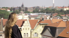 A young and pretty woman walking in the Vysehrad park in Prague Stock Footage