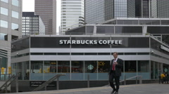 Man in Suit Walking in front of Starbucks Coffee Stock Footage