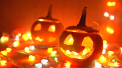 Pumpkin with lights closeup on a wooden table in the dark. Stock Footage