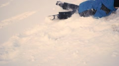 Child rolls head over heels with the hill in the snow Stock Footage