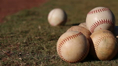 An array of baseballs on a field. Stock Footage