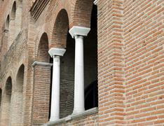 Arched windows and columns on the facade of an ancient medieval church Kuvituskuvat
